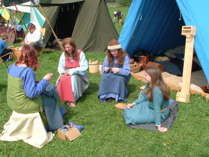 A group of girls sewing and gossiping?